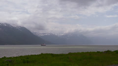 Alaska Ferry Heading South from Haines Cloudy Day Grass in Foreground Stock Footage