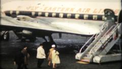 560 - air travel on a 1950's propeller driven plane - vintage film home movie - stock footage