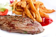 Stock Photo of beef meat with tomato and french fries