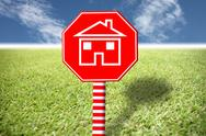 Stock Illustration of red labels with home picture on grass and blue sky.