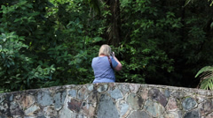 Woman foot bridge rainforest Puerto Rico HD 0710 Stock Footage