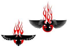 black eagles with tribal flames - stock illustration