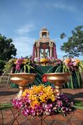 gold brahma statue in worshiping festival. - stock photo