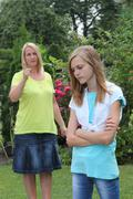 young teenage girl in an argument with mother - stock photo
