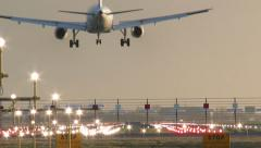 4K Airplane landing at dusk - stock footage