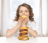 Girl with junk food Stock Photos