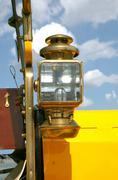 Oil lantern on an ancient car Stock Photos