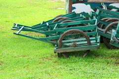 wooden cart in green. - stock photo
