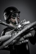 Starfighter with huge plasma rifle, fantasy concept, military helmet and gogg Stock Photos