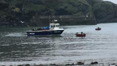 Fishing boat in harbour Stock Footage