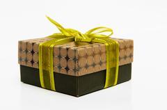 Green box yellow bow and ribbon Stock Photos