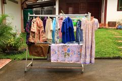 Laundry hanging out to dry outdoors in rains. Stock Photos