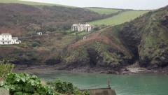 Large house over looking the sea Stock Footage