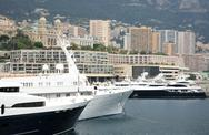 Stock Photo of luxurious yachts on background the monte carlo casino monaco