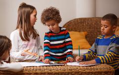 Group of kids are playing at home Stock Photos