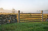 Stock Photo of limestone fence and misty landscape.tn