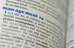 Management word on the book - stock photo