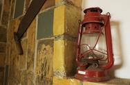 Stock Photo of old red lamp on stone bricks wall