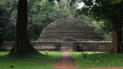 Sri Lanka-tilt up to ancient temple at Pidurangala Stock Footage