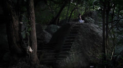 Sri Lanka_woman meditates on rock-Pidurangala-2 Stock Footage