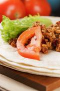 wheat tortillas with ingridients for burrito - stock photo
