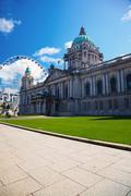 Belfast city hall and ferris wheel Stock Photos