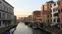 Locals stroll along Venice canal - stock footage
