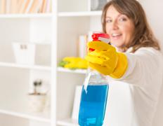 beautiful young woman cleaning her house - stock photo