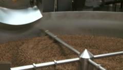 Roasted coffee beans in cooling bin zoom out ws Stock Footage