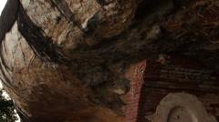 Sri Lanka-Tile down rock to sleeping Budhha on Pidurangala Stock Footage
