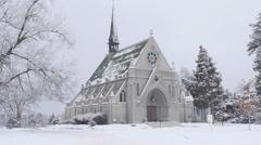 Seamless Loop Chapel in Snowstorm Stock Footage