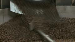 Roasted coffee beans exiting commercial size roaster, close up zoom in - stock footage