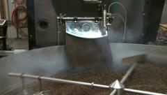 Roasted coffee beans exiting commercial size roaster, zoom in Stock Footage