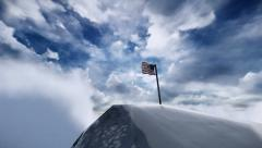 American flag on frozen mountain Stock Footage