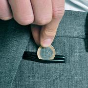 Man with euro coin Stock Photos