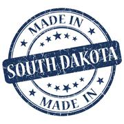 made in south dakota blue round grunge isolated stamp - stock illustration