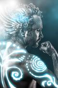 Lost gods, mythology concept, man with blue neon tribals, tattoo Stock Photos