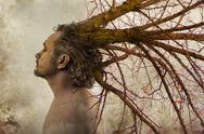 Stock Photo of freedom concept,man with tree branches coming out of his head