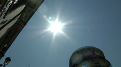 Sunny sky pans down to Madrid intersection Stock Footage