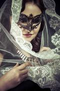 vestal.veiled virgin, spirituality concept. woman with mask posing in studio. - stock photo