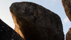 Sri Lanka-Tilt move climbing up rocks Stock Footage