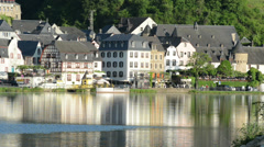 Cityscape of Beilstein and Mosel River. People and cars are passing by. Stock Footage