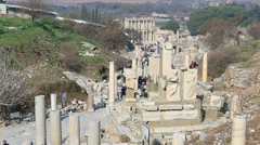 Tourists walking ruins columns street Stock Footage
