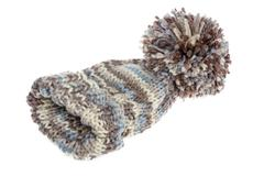 Warm woolly winter hat with a huge pompom Stock Photos