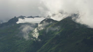 Stock Video Footage of Alaskan Mountainside Mist and Cloudy Vapours over Glacier