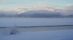 Alaskan Winter Scenic - Chilkat River Valley Freezing Foggy Mist and Snow Moun Stock Footage