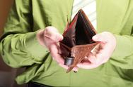 Stock Photo of empty wallet in male hands - poor economy