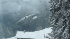 Winter hut in the mountains seen from cable car Stock Footage