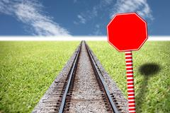 Railway traffic on the lawn and red traffic signs. Stock Photos