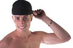 Shirtless young man with black baseball hat Stock Photos